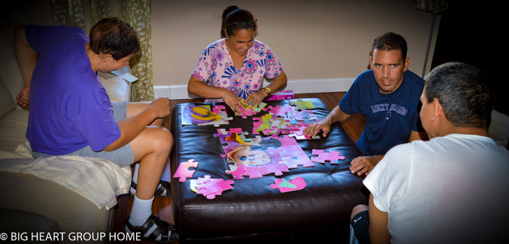 Tampa Group Home Residents and staff putting a puzzle together